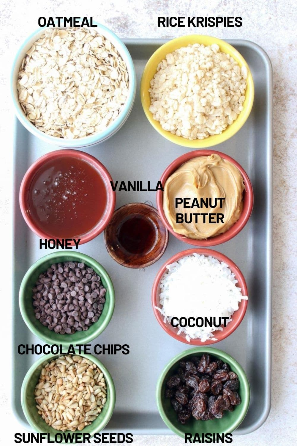 Cookie sheet with all of the ingredients needed to make the balls