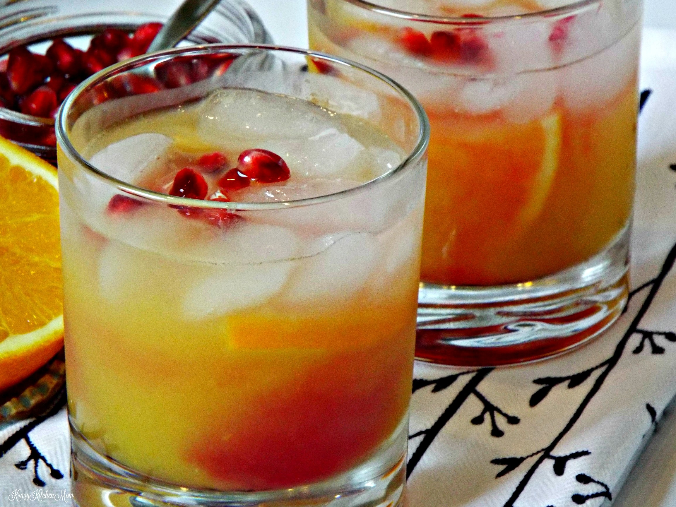 a cocktail with cranberry garnish