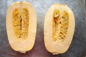 Spaghetti squash cut in half with seeds