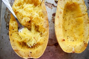 Spaghetti squash with fork removing the flesh