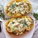 top view of Spaghetti squash in white dish with herbs