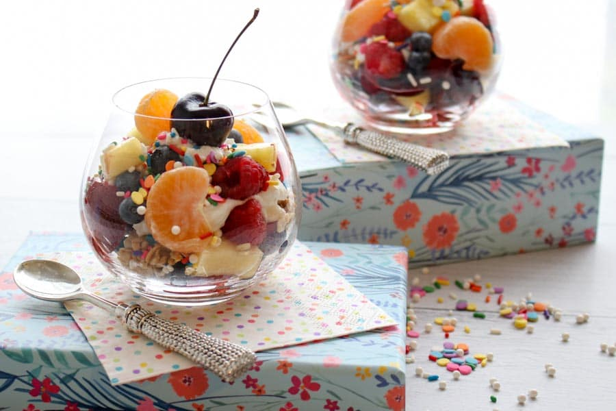 Breakrast Fruit Salad in a jar on a flowered box