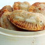 a basket filled with small apple hand pies
