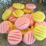 bowl of pink and yellow candies