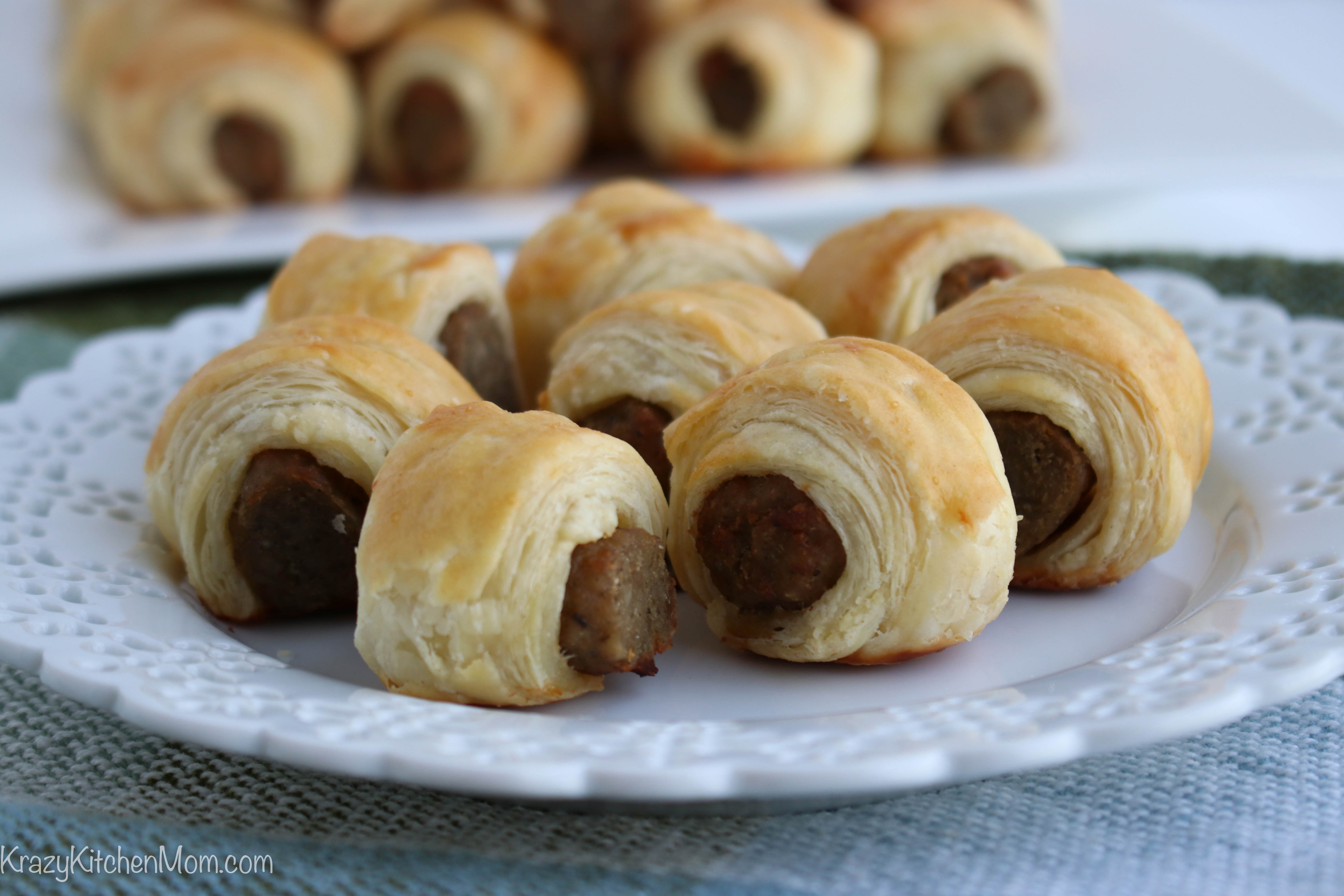 close up of a plate of sausages rolled in pastry
