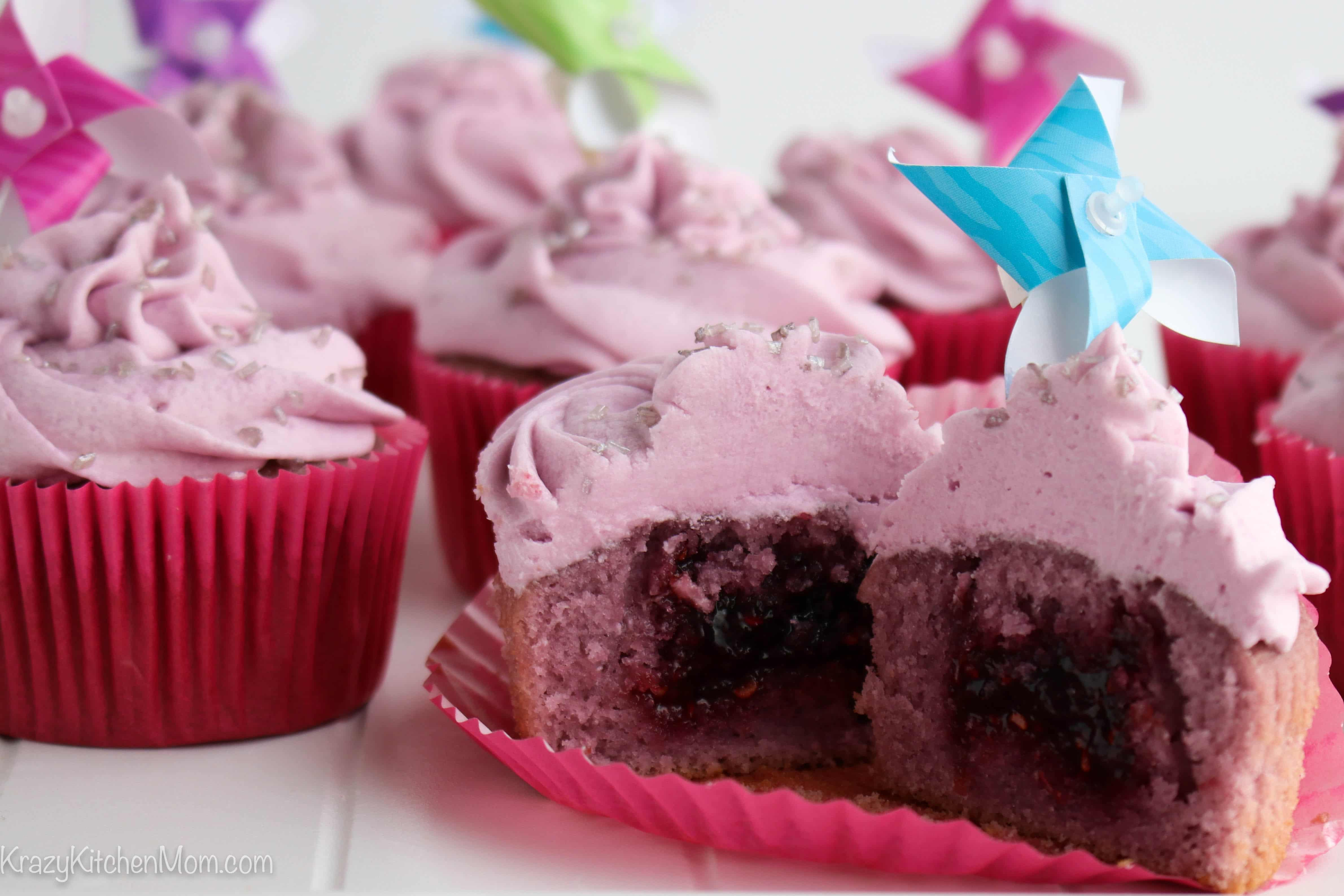 Red Sangria Cupcakes with Raspberry Filling cut in half