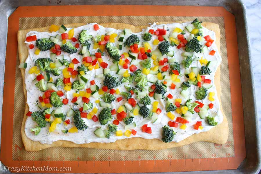 Veggies pizza process add red pepper