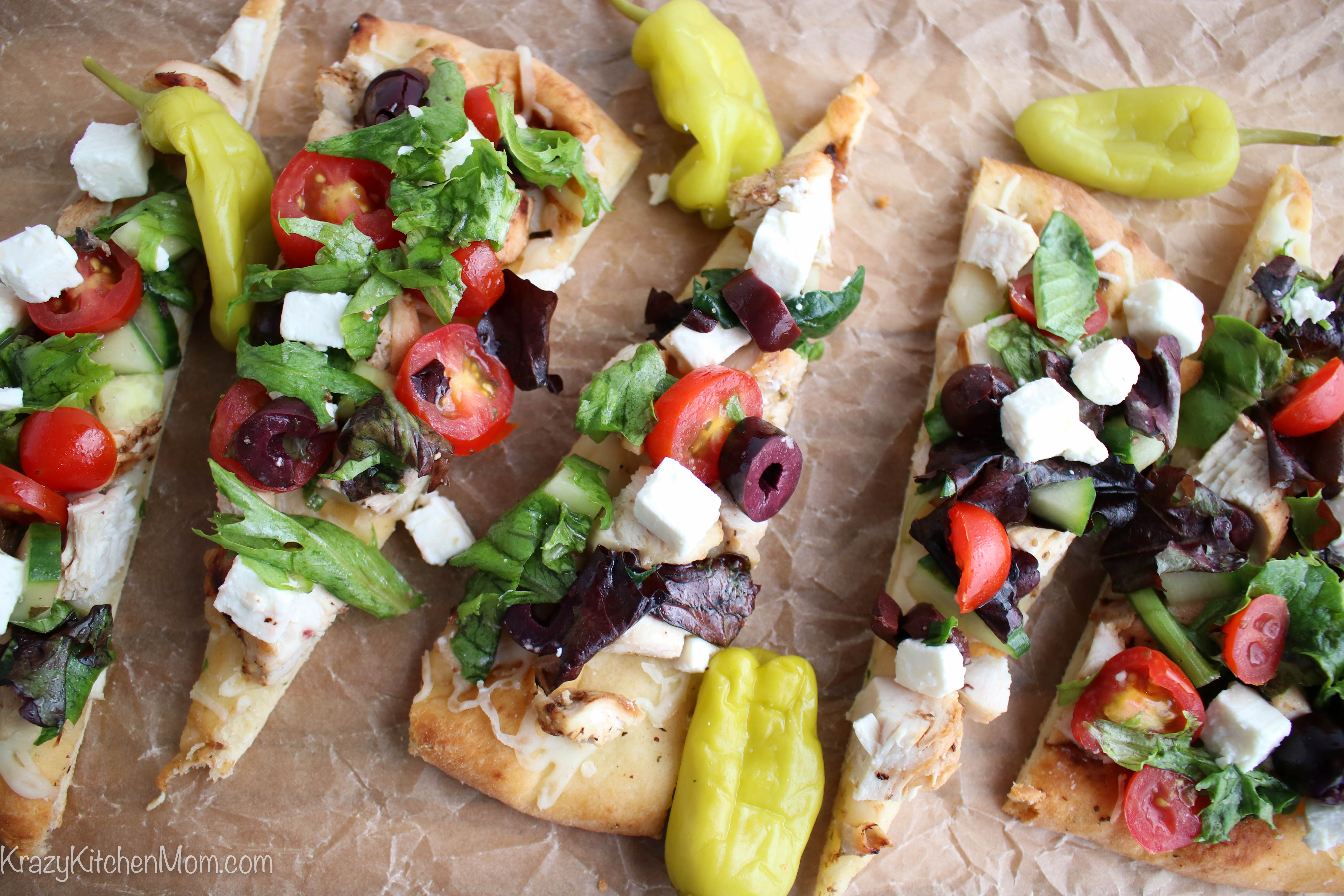 flatbread topped with Greek salad and peppers