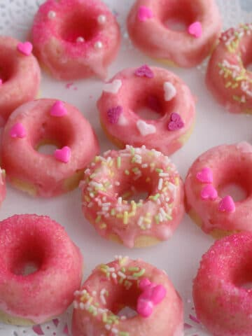These Mini PinkLemonade Donuts are baked and glazed with fresh lemon juice and confectioners sugar.
