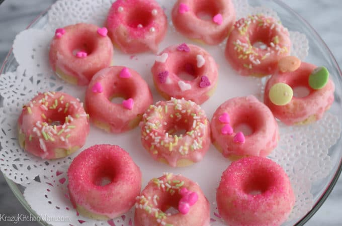 These Mini Pink Lemonade Donuts are baked and glazed with fresh lemon juice and confectioners sugar.