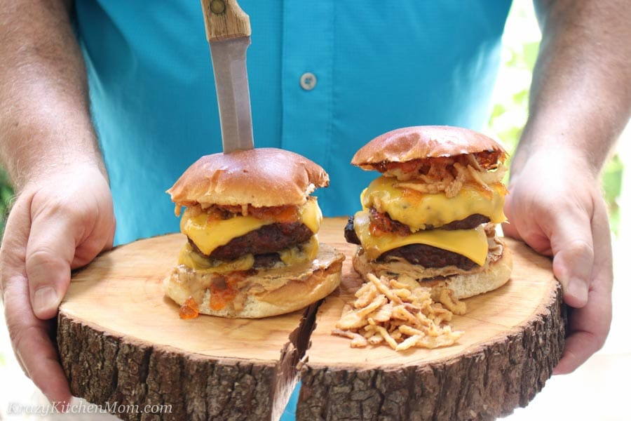 Man holding tray with Peanut Butter and Jelly Burger