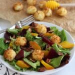 Fried Goat Cheese Balls on a salad