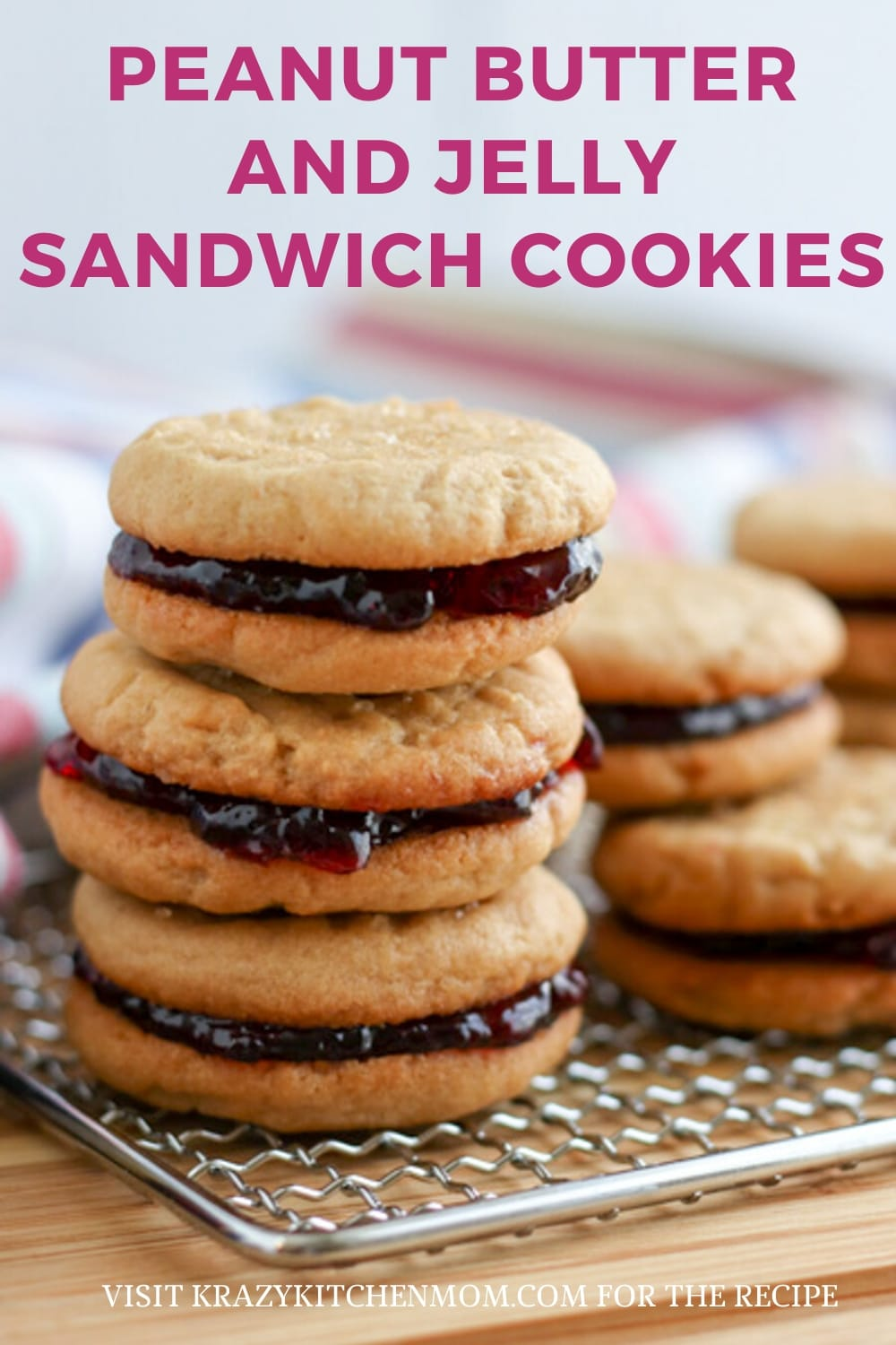 Two peanut butter cookies sandwiched together with grape jelly make the best Peanut Butter and Jelly Sandwich Cookies. via @krazykitchenmom
