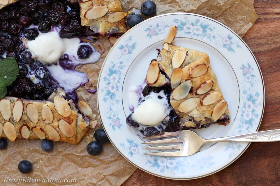 Slice of blueberry galette with ice cream