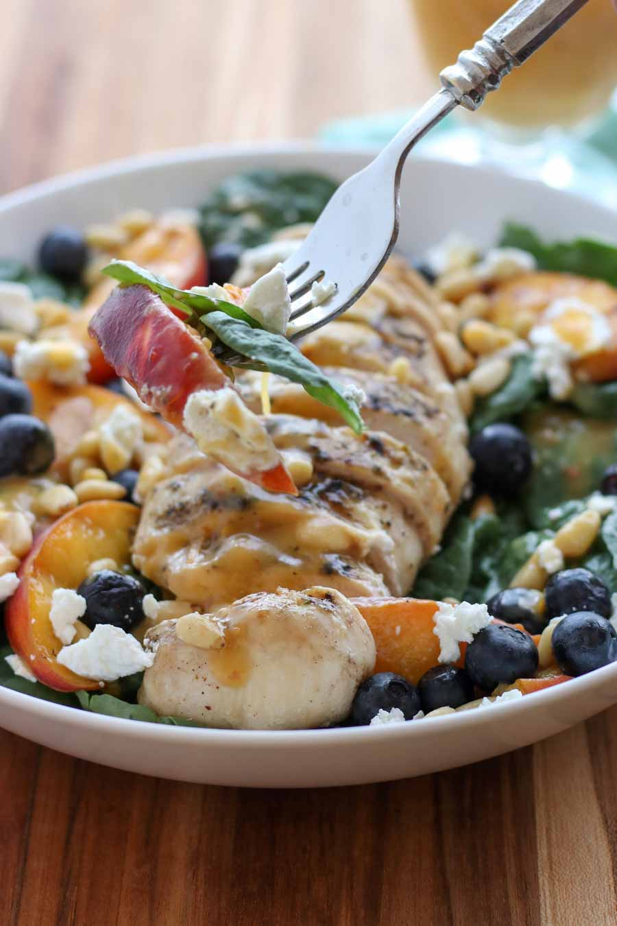 Grilled Peach Chicken Salad on a fork