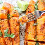 Chili Honey-Lime Roasted Sweet Potatoes with a fork