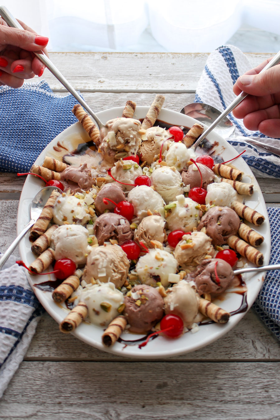 Ice Cream Party Platter with two hands holding spoons
