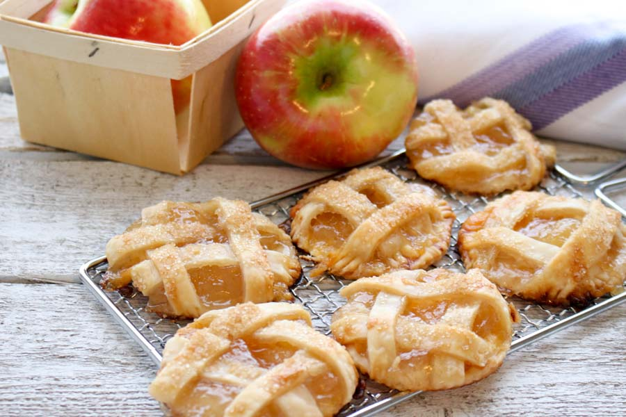Mini Apple Cheddar Pies with an apple