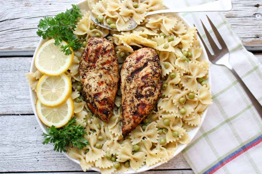Two chicken breasts on pasta - overhead shot