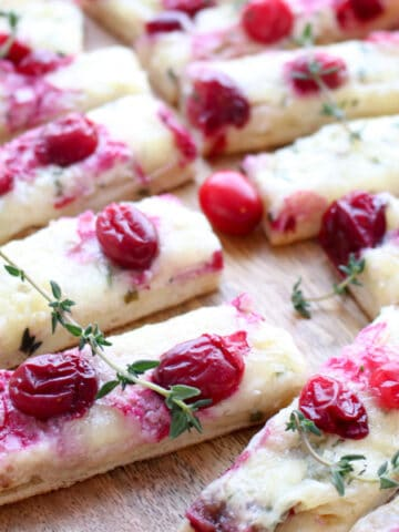 close up of three cheese cranberry flatbread slices