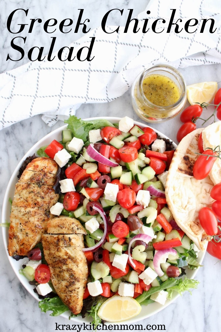 Greek Chicken Salad is made with leafy lettuce, feta cheese, olives, cucumbers, tomatoes, onion, bell peppers, and celery. It's topped with Greek seasoned grilled chicken and drizzled with Greek dressing. via @krazykitchenmom