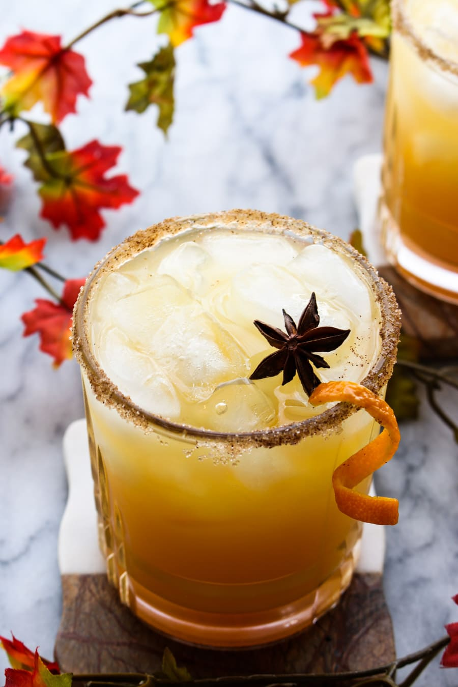 Apple cider margarita with orange peel garnish
