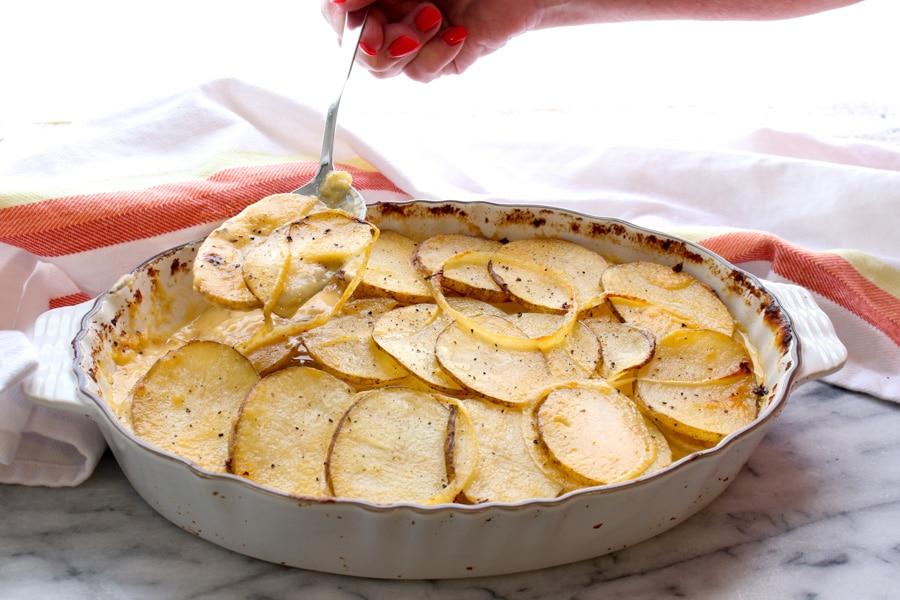 Cheesy Au Gratin Potatoes and spoon
