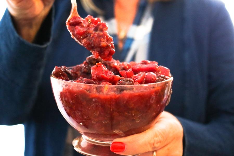 Hand serving cranberry chutney