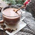 hand stirring chai hot chocolate