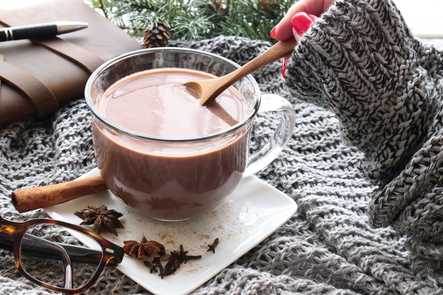 hand stirring chai hot chocolate