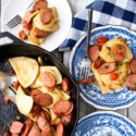 Pierogi and Kielbasa skillet with plates