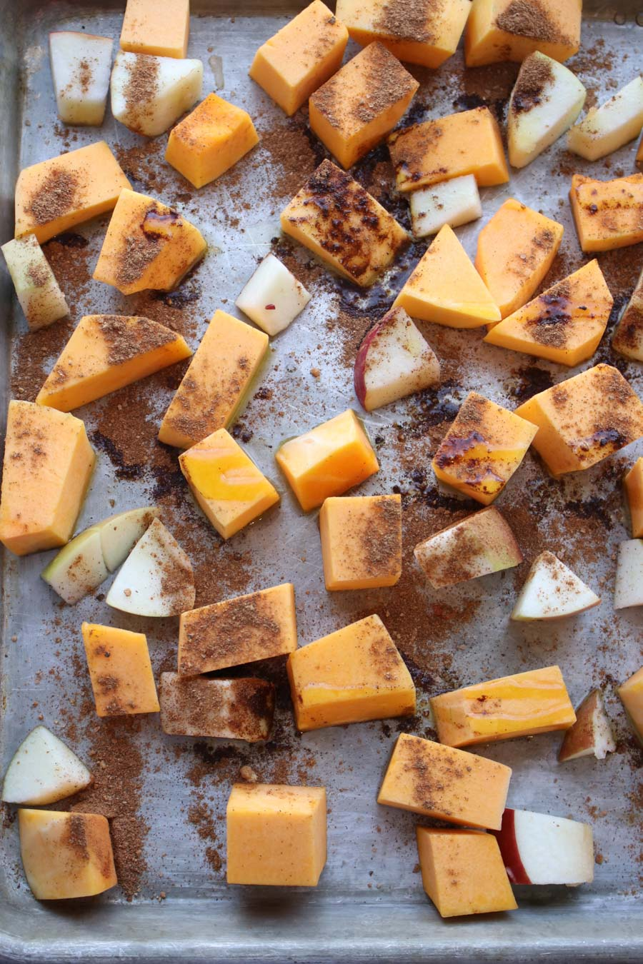 diced squash and apples on roasting pan