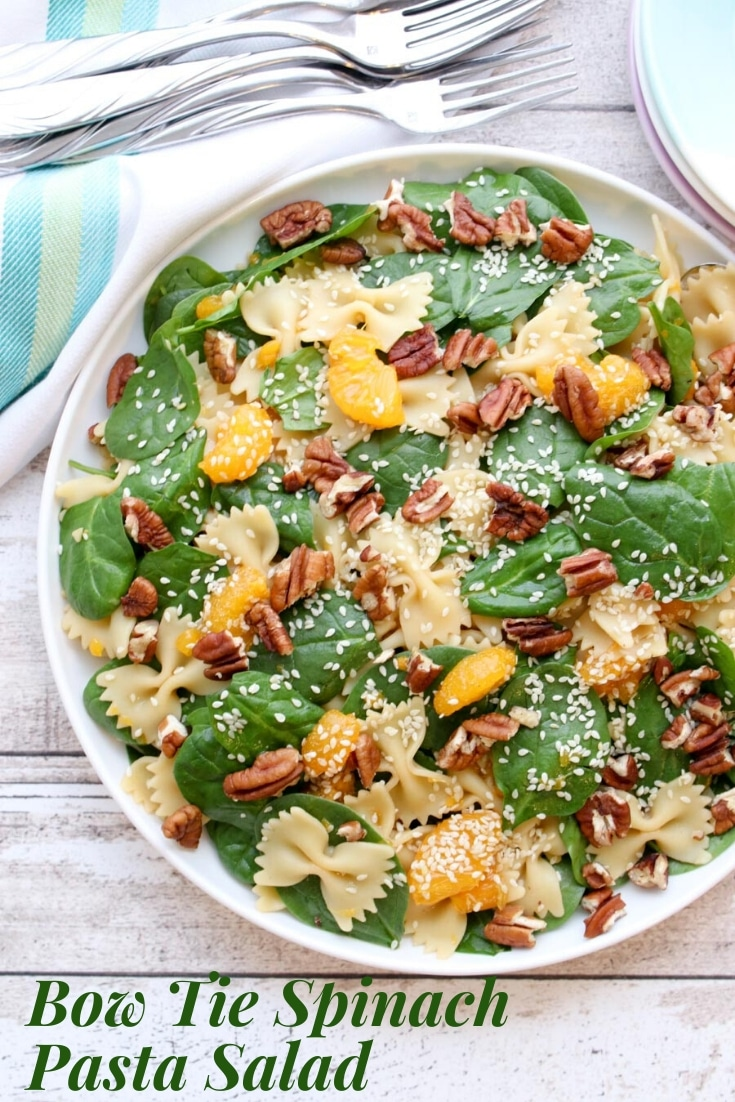 Bow Tie Spinach and Pasta Salad is made with Farfalle pasta, fresh baby spinach, mandarin oranges, and toasted walnuts with an Asian ginger dressing.  via @krazykitchenmom