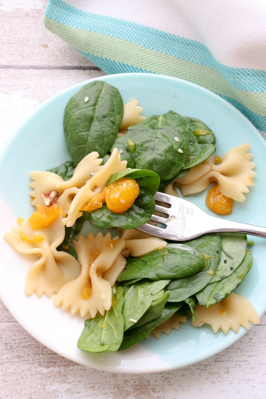 single dish of spinach pasta salad