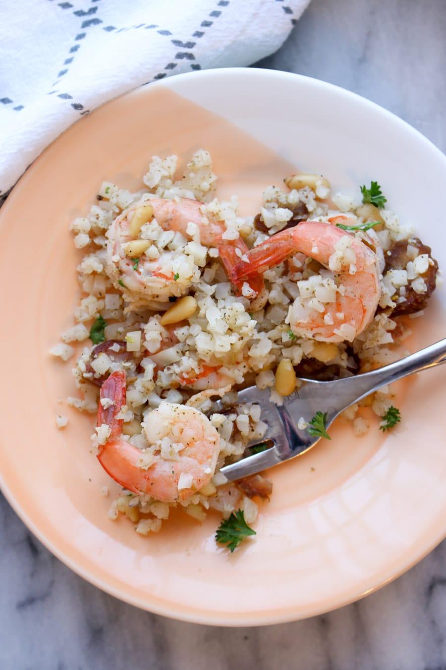 one serving of zaatar shrimp and cauliflower rice