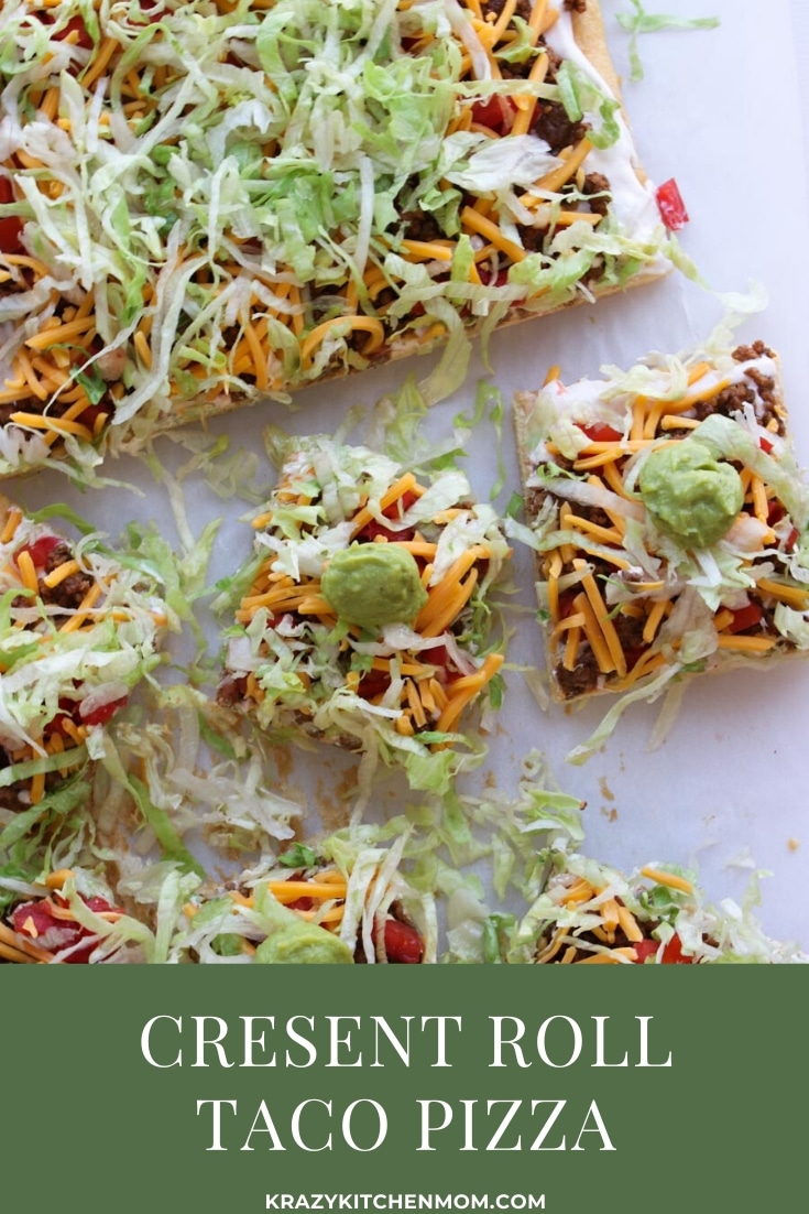 Two tubes of crescent roll dough, ground beef, taco seasoning, cream cheese, and some veggies are all you need to make Crescent Roll Taco Pizza. via @krazykitchenmom