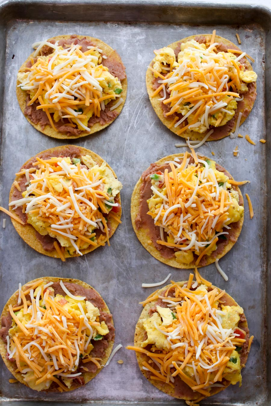 tostadas with beans, scrambled eggs, shredded cheese