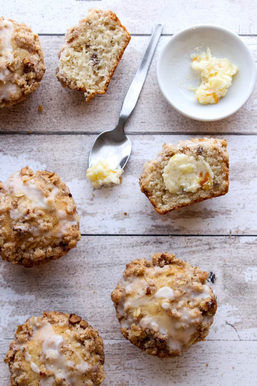 Buttered muffin with a spoon of butter