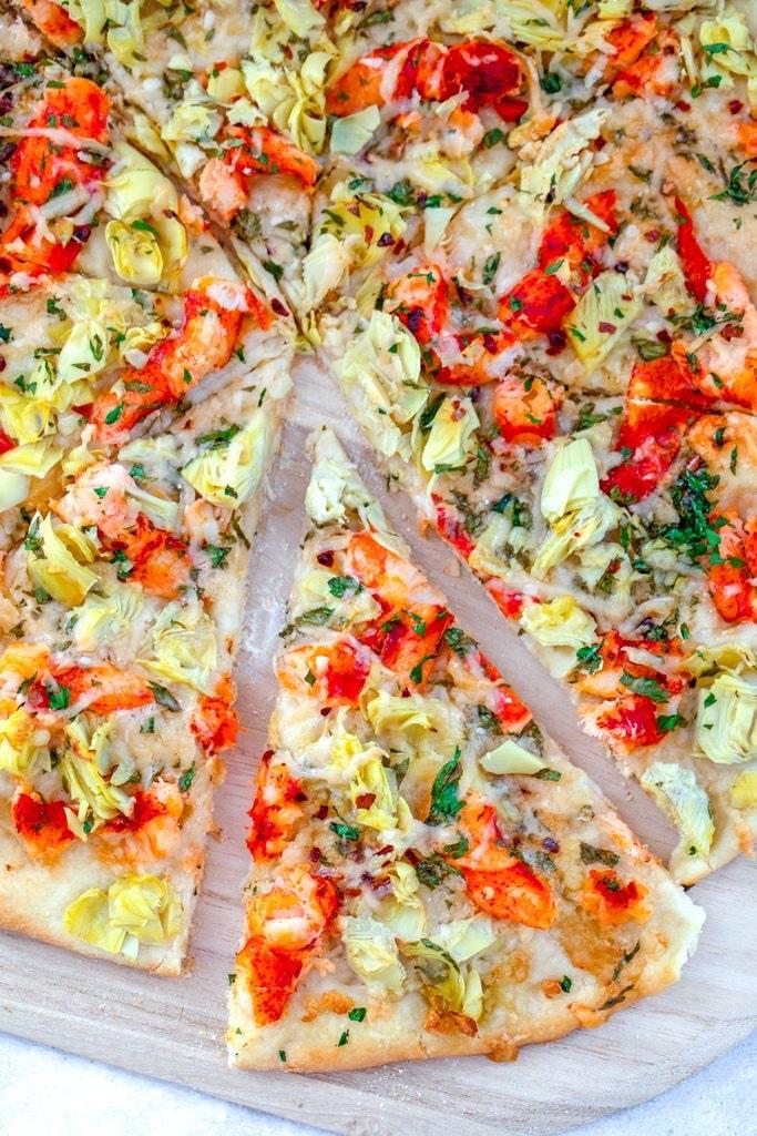 A slice of artichoke and tomato pizza