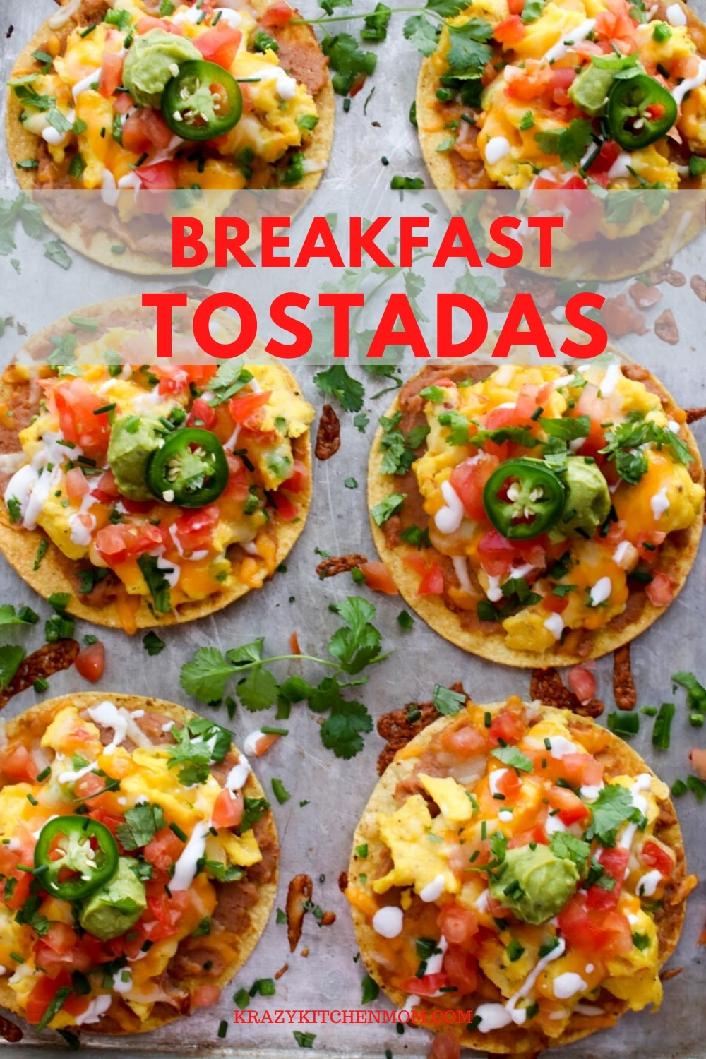 Huevos Rancheros Breakfast Tostadas is a great recipe for breakfast, lunch, or dinner. They're made with creamy refried beans, fluffy scrambled eggs with melted cheese, diced tomatoes, diced, onions, guacamole, sour cream, cilantro, and jalapeños. via @krazykitchenmom