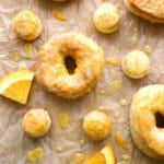 Orange Glazed donuts and donut holes on parchment paper