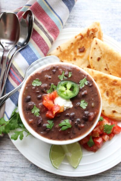 Bowl of black bean soup with quesdillas