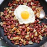 Corned Beef Hash in skillet with sunny side egg on top