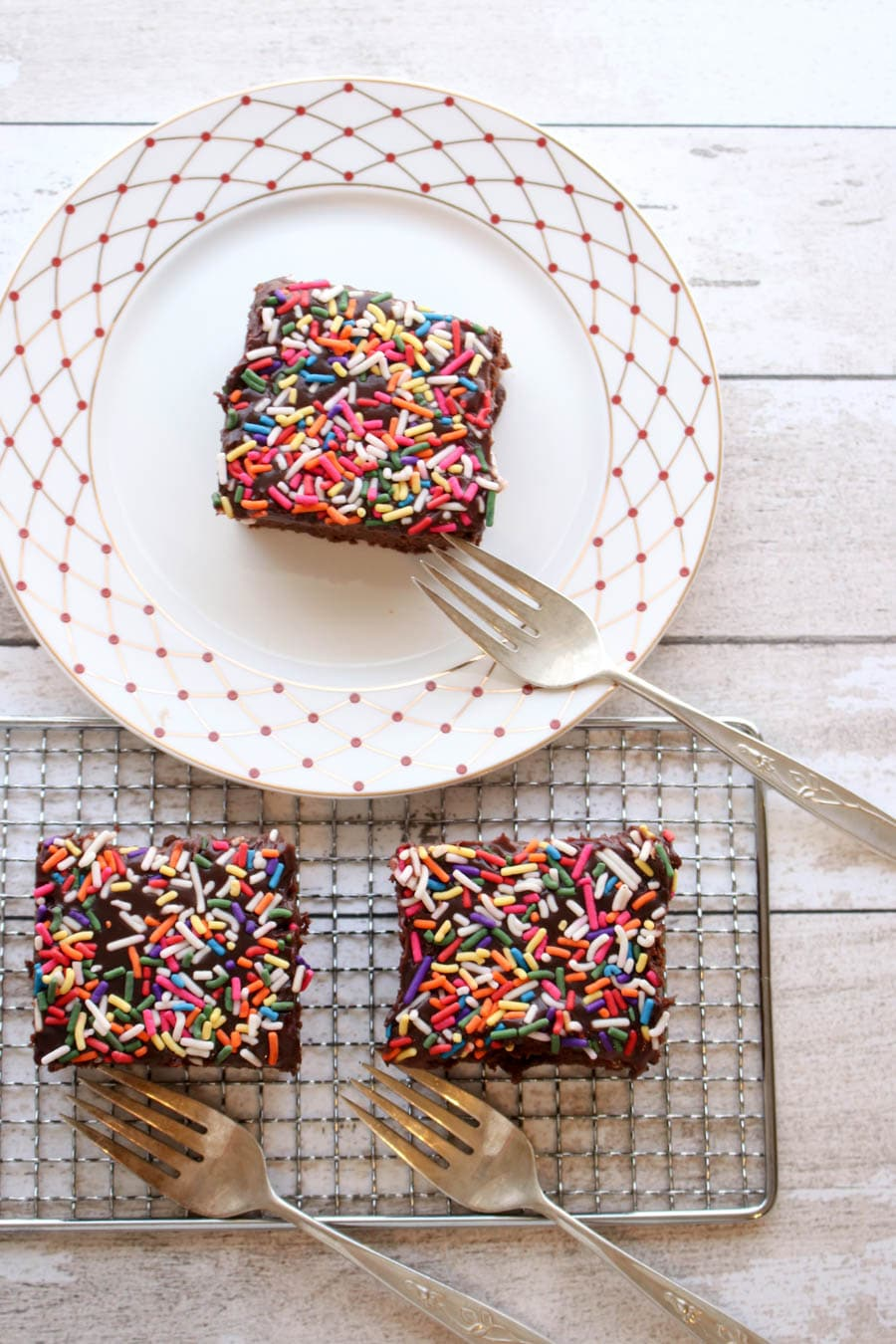 three slices of chocolate cake with sprinkles