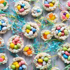 A bunch of rice krispy nests filled with candy