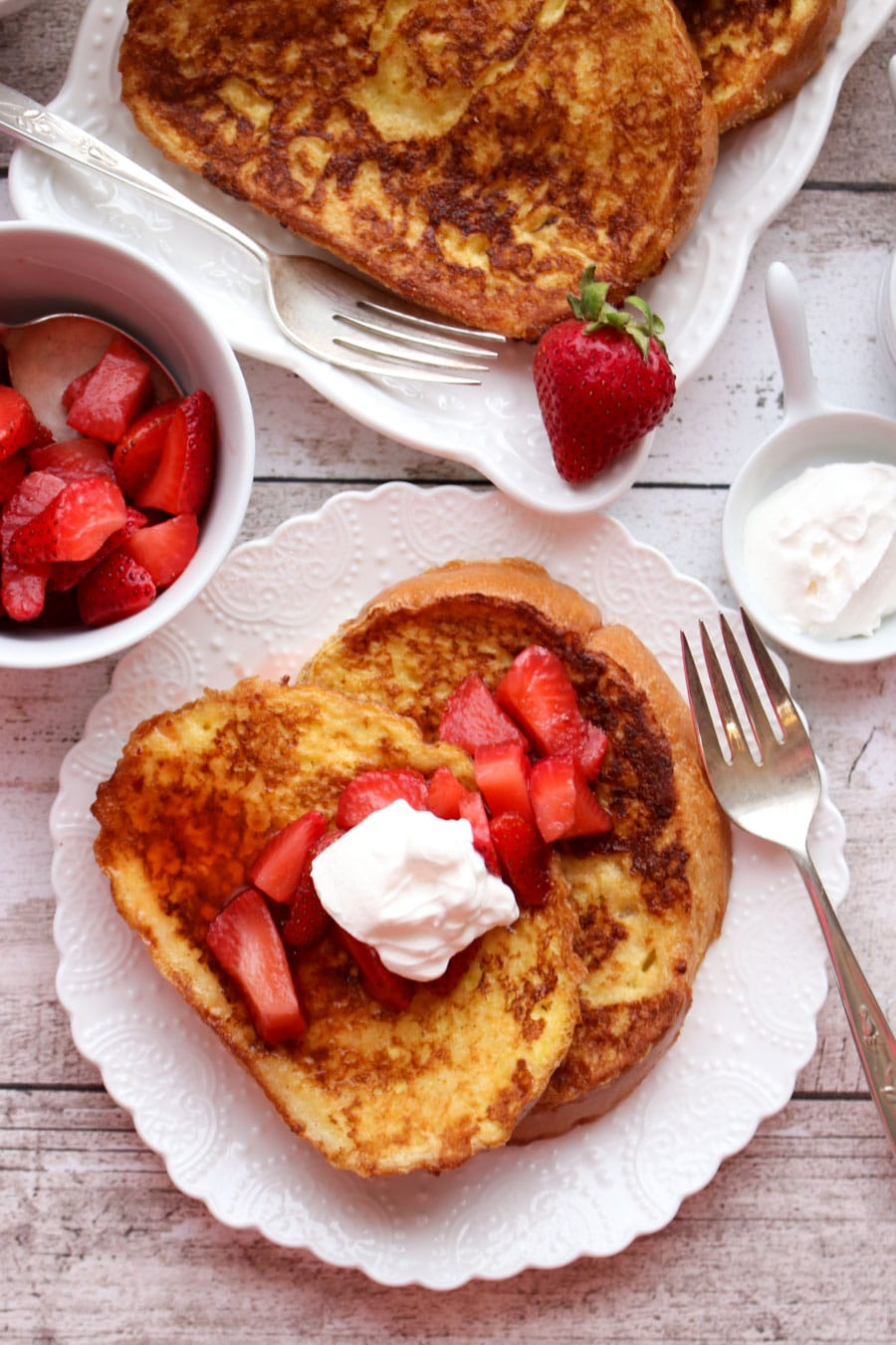 French toast topped with strawberries and sour cream