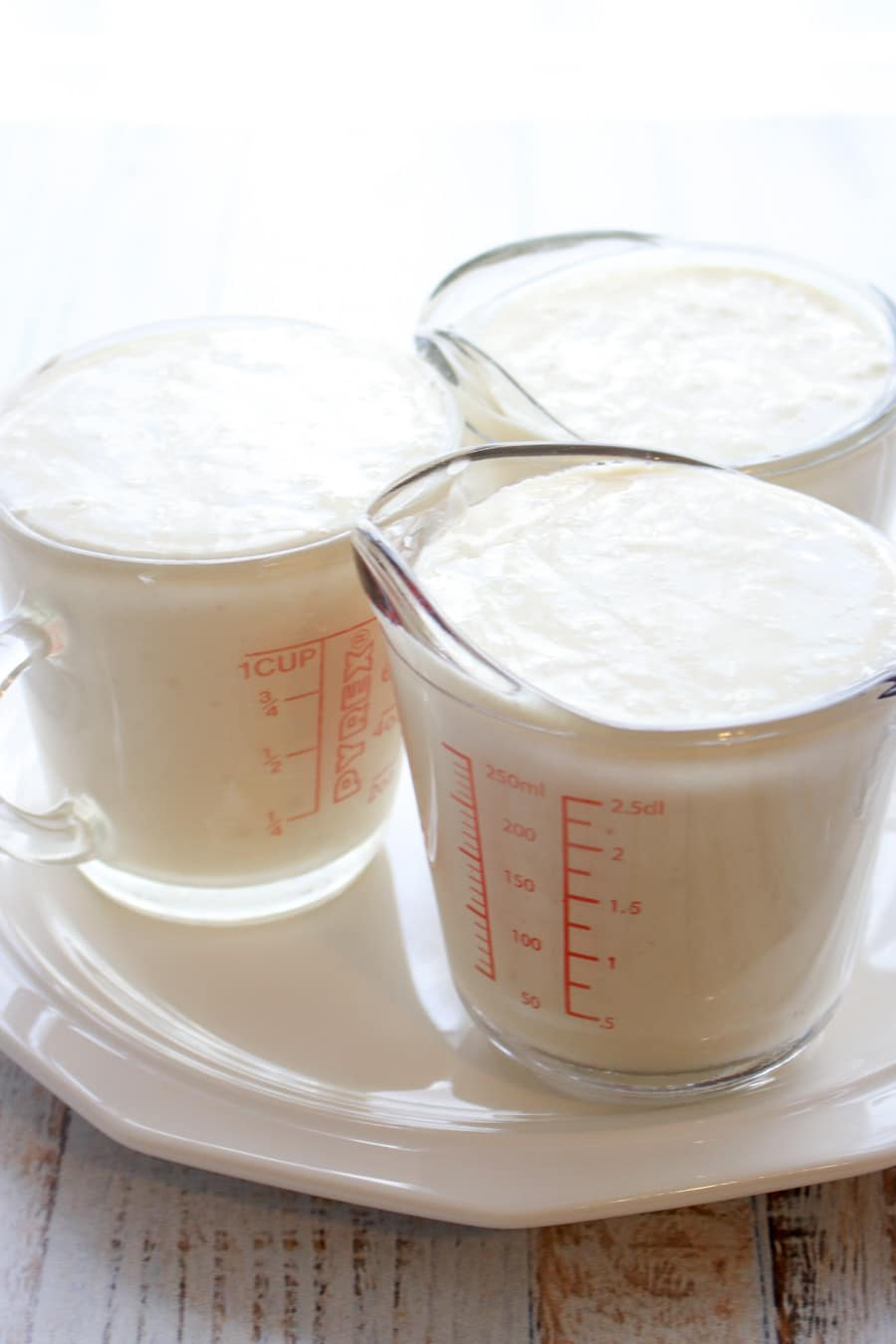 white cake mix in three 1 cup measuring cups