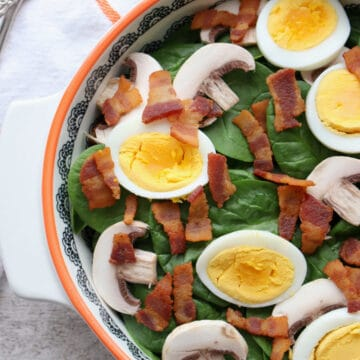 Bowl of Spinach Salad with bacon, mushrooms, eggs
