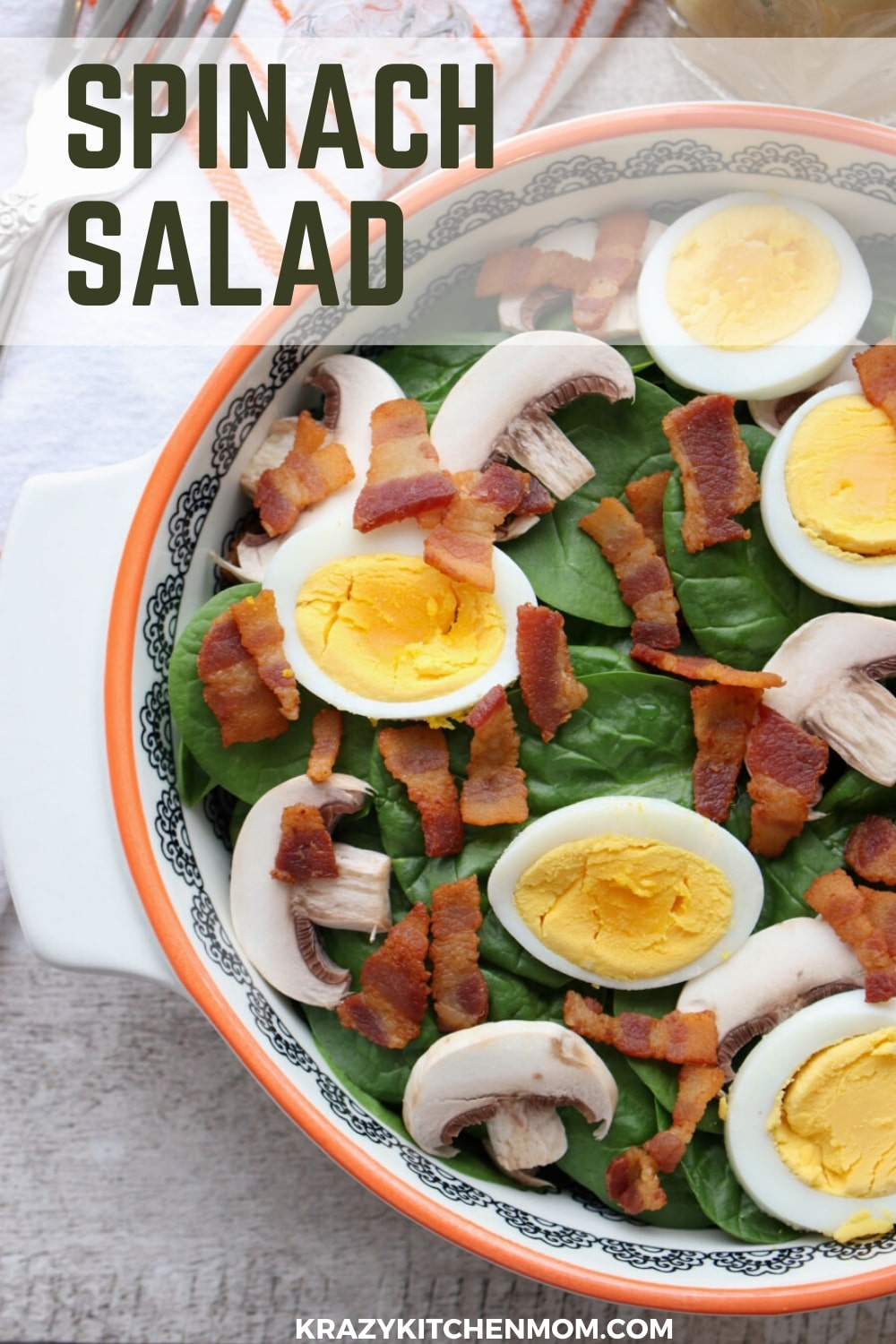 Spinach Salad with Warm Bacon Dressing is a classic salad made with a vinaigrette that uses bacon drippings instead of oil.  via @krazykitchenmom