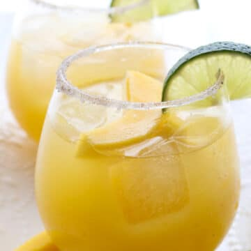 Mango Margarita with a slice of mango and lime